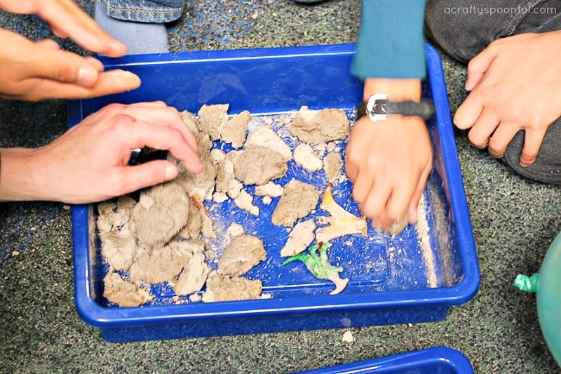 Kids playing with homemade dinosaur fossils