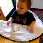 Neatnik Saucer High Chair Cover Goes Out to Eat!