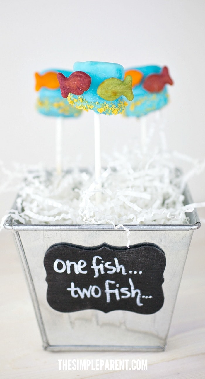 Try making these Dr Seuss Snacks Kids Love! These One Fish Two Fish Red Fish Blue Fish Marshallow pops are a fun way to celebrate!