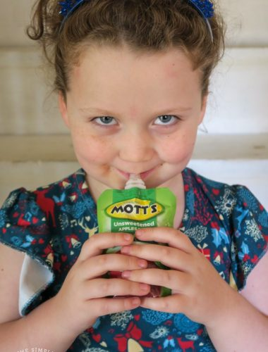 Girl eating applesauce pouch