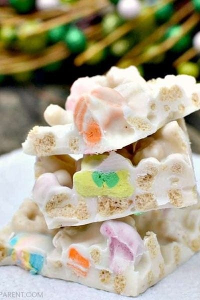 Lucky Charms Cereal Treats for St. Patrick's Day - Lucky Charms candy bark is an easy recipe to make for St. Patrick's Day! The marshmallows make these Lucky Charm bars cute and tasty! Check out the simple ingredient list!