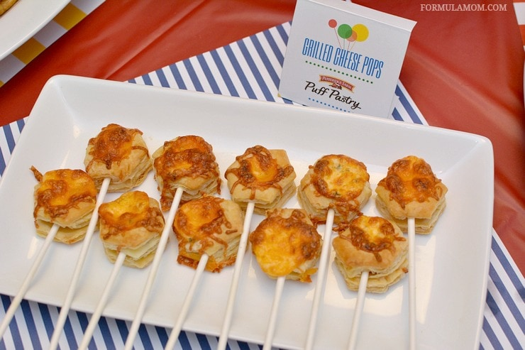 Birthday party food ideas don't have to be complicated to be delicious! Take a fun approach to classic flavors with these Puff Pastry Grilled Cheese Pops!