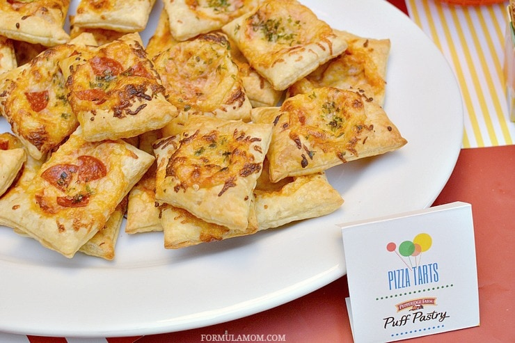 Birthday party food ideas don't have to be complicated to be delicious! Take a fun approach to classic flavors with these Puff Pastry Pizza Tarts!