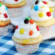 These easy M&M Cupcakes take a box cake mix and add some pops of color and flavor to it! If you're looking for fun and easy cupcake recipes, try this one!