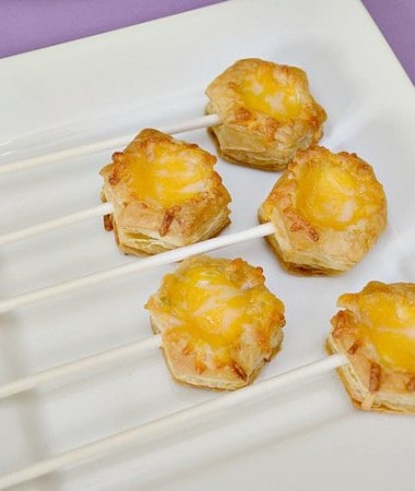 Make these easy Grilled Cheese Bites for your next baby shower, baby sprinkle, or any party! Put them on sticks and you'll have simple Grilled Cheese Pops!