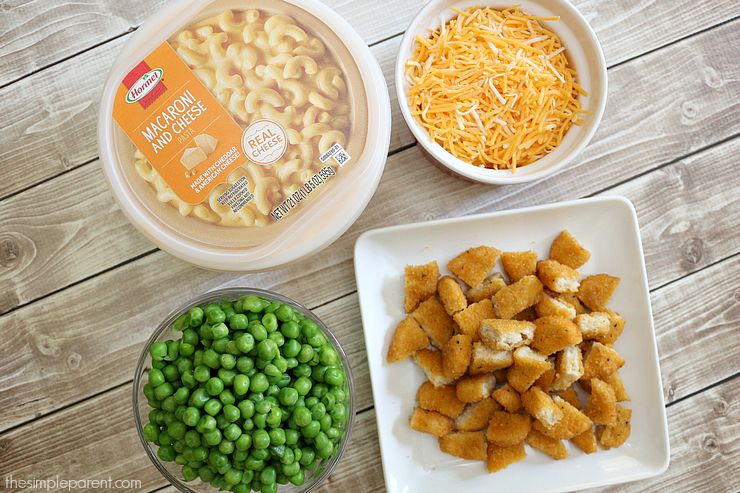 Need an easy family dinner idea? Make this quick and easy Chicken Nugget Macaroni and Cheese casserole! Kid-friendly and so easy to make!