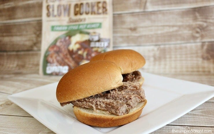 Slow cooker pot roast sliders are perfect for game day! They are bite sized and easy to customize. Plus, the slow cooker recipe means minimal prep!