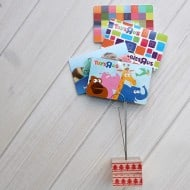 Turn your gift cards into a cute gift with this DIY Gift Card Holder! It's easy to make and adds a little something extra to your holiday gift cards!