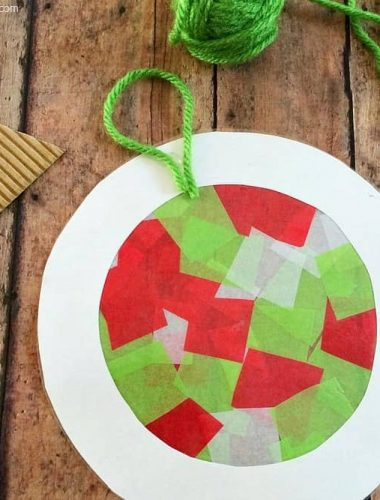 These tissue paper ornaments are a fun Christmas craft for kids! You can also use them to decorate your windows since they double as sun catchers!
