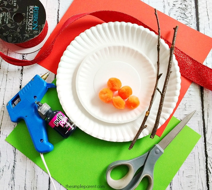 Get everything you need together to make snowman paper plate crafts with your kids!