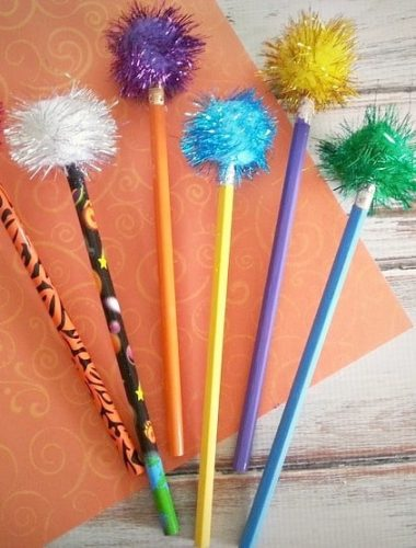 Read The Lorax by Dr. Seuss then make these easy Truffula Tree Craft pencils!