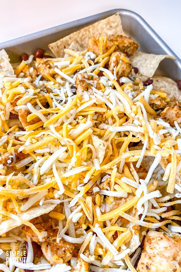 Nachos with shredded cheese on top