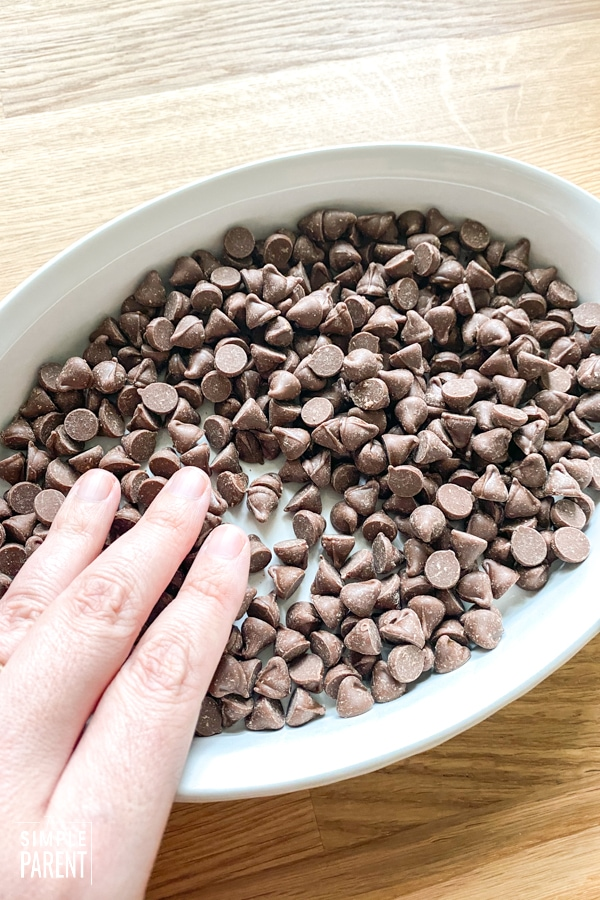 Casserole dish with a layer of chocolate chips in the bottom