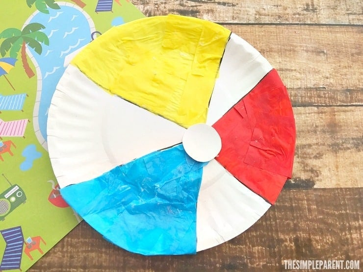 Make this beach ball paper plate craft with your kids this summer!