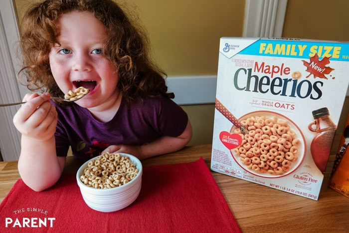 Young girl eating Maple Cheerios