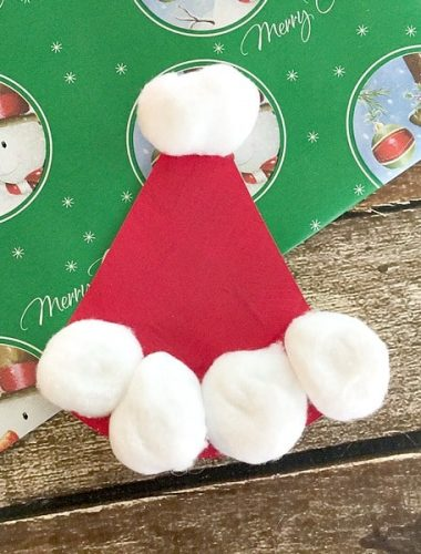 Make this easy paper plate Santa Hat craft with your kids this holiday season!