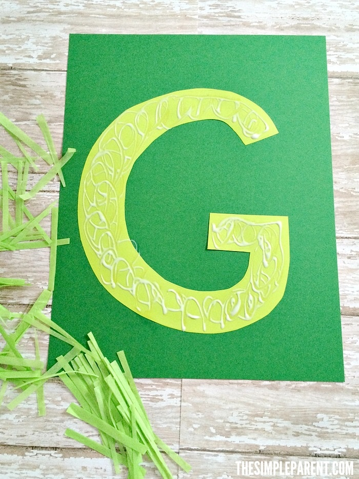 Preschool alphabet letter crafts are fun to do with your kids! Celebrate spring with our G is for Grass craft!