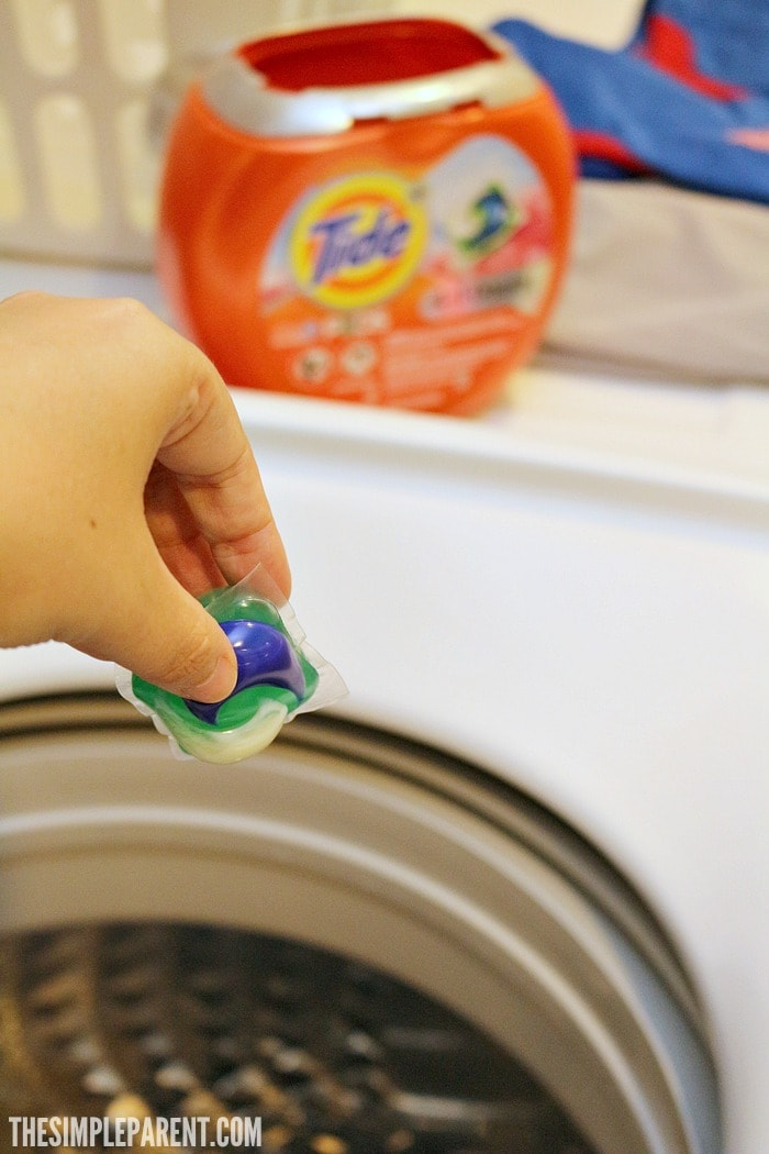 Tide is a big part of our easy baseball mom ideas for how to wash baseball pants.