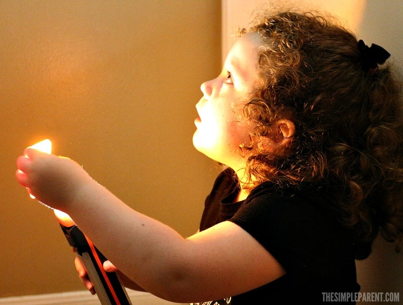 Encourage learning through play with these STEM pre k activities using a flashlight and colors!