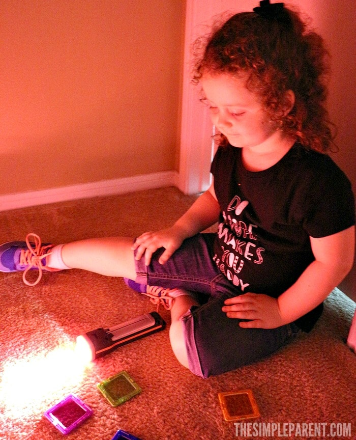 Encourage learning through play with these preschool STEM activities using a flashlight and colors!