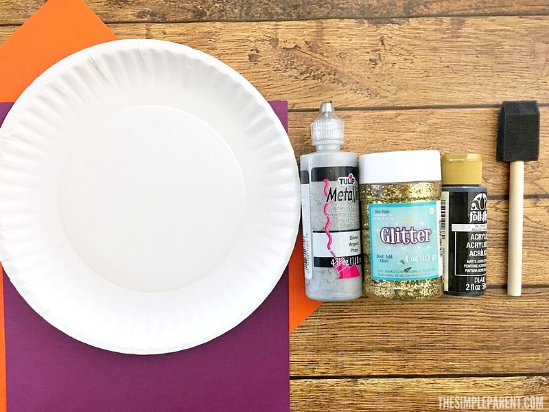 Materials you need to make this spider web paper plate craft!