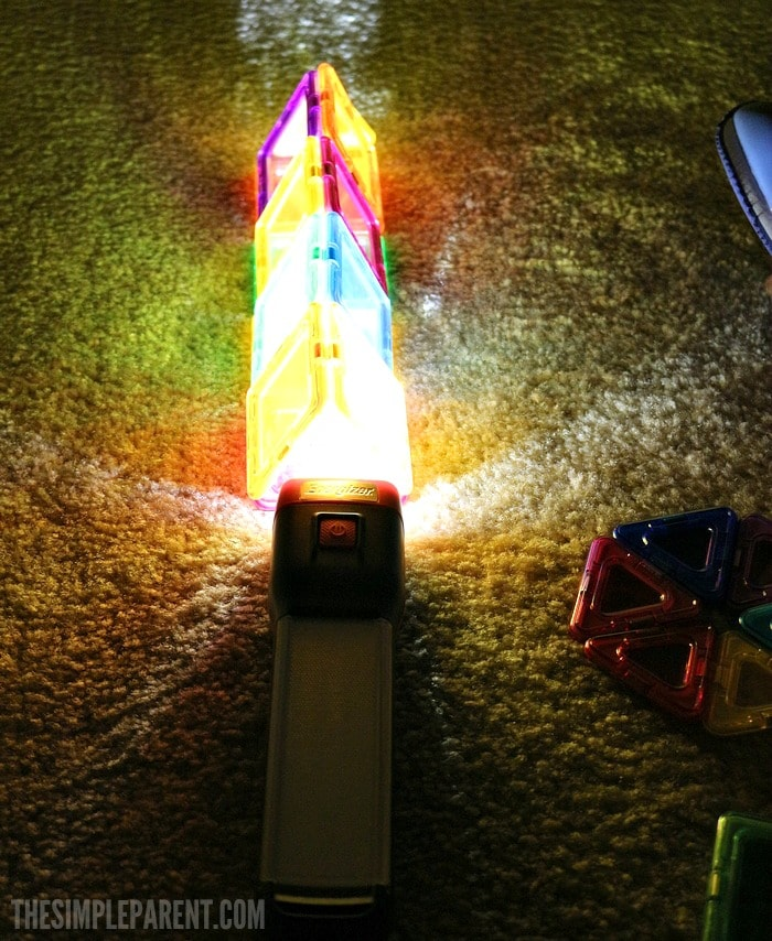 Encourage learning through play with these STEM preschool activities using a flashlight and colors!