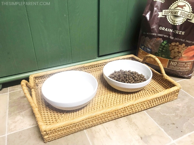 Supreme Source Healthy Dry Dog food in bowl with water bowl.