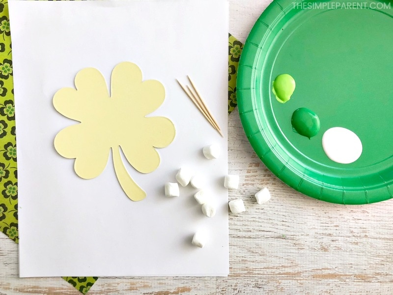 Gather the supplies to make a shamrock by marshmallow painting!