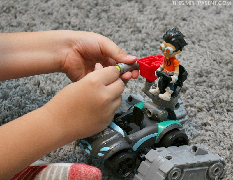Child playing with Rusty Rivets building toys.