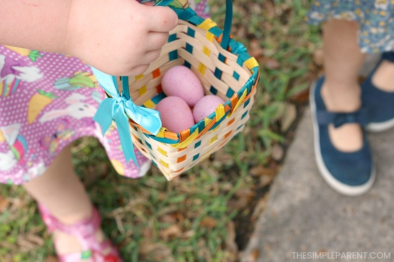Filling an Easter basket with eggs for these easy Easter egg hunt ideas!