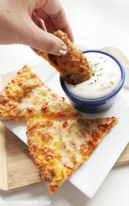 Dipping pizza crust in the easy garlic sauce.
