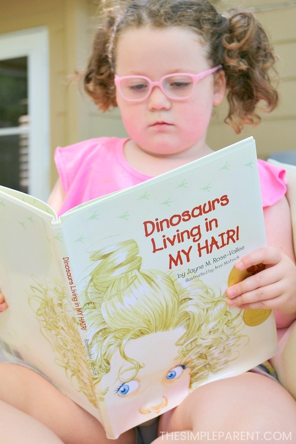 Reading Dinosaurs in My Hair book from our Babbleboxx.