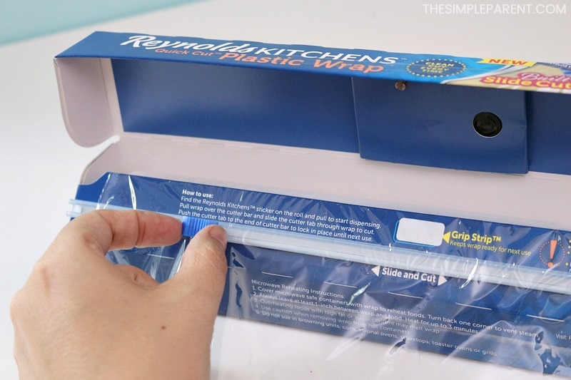 The new slide cutter on Reynolds Kitchens Plastic Wrap makes finger painting for toddlers easy!