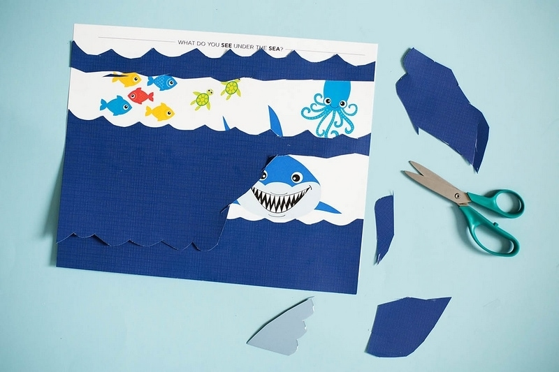 Ocean activities for preschoolers like this cutting craft help promote fine motor skills.