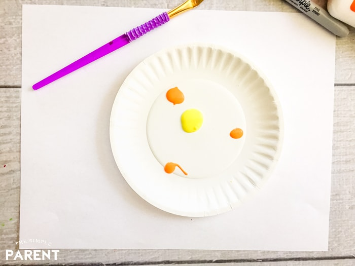 Yellow and orange paint to make a paper plate puffer fish craft