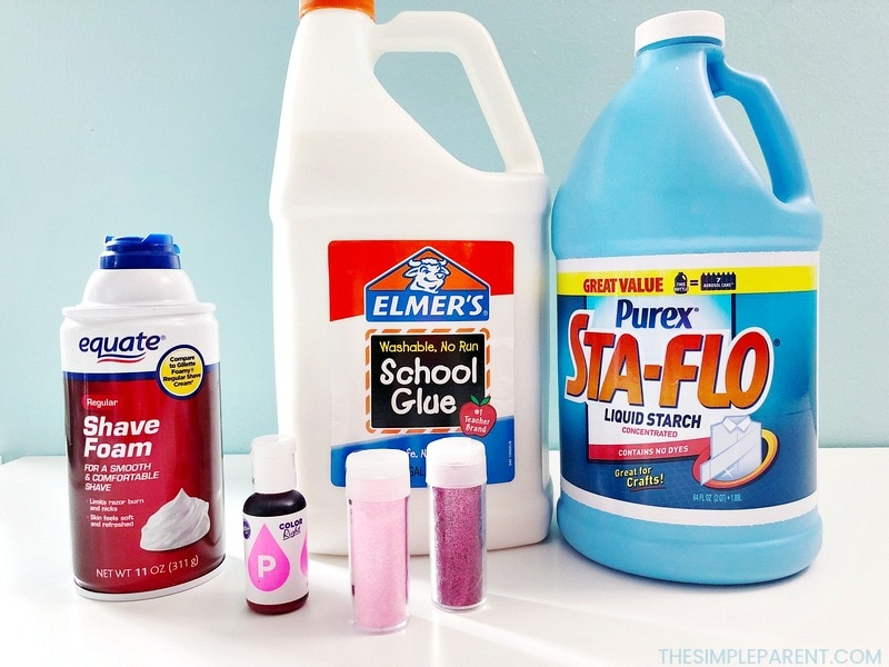 The ingredients needed to make pink fluffy slime with shaving cream.
