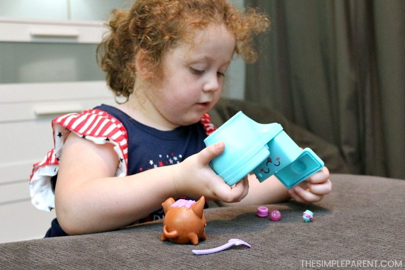 Playing with Pooparoos Surpriseroos. You can store all of the pieces in the cute toilet!
