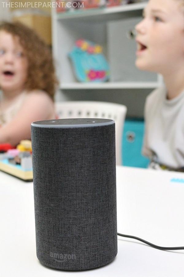 Kids using Amazon Echo to explore Alexa Skill Blueprints while playing.