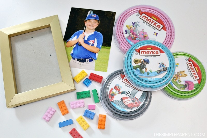 Mayka Toy Block Tape and other materials to make a Lego picture frame craft.
