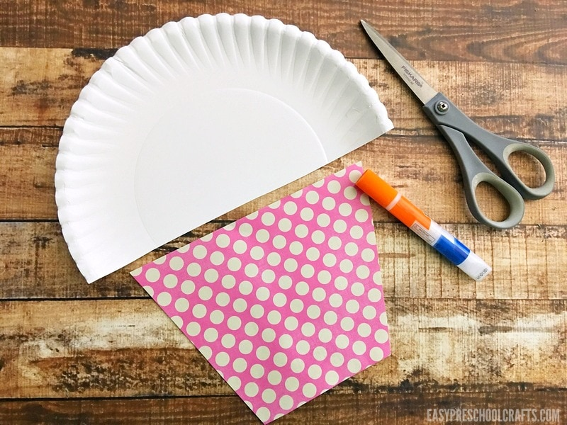 Cutting the paper plate to make a cupcake craft