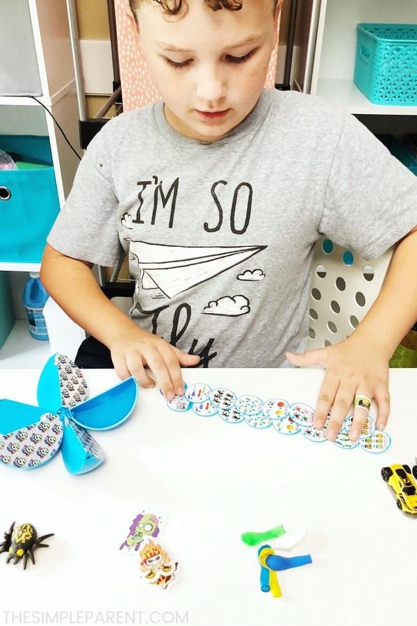 Boy opening ZURU 5 surprise toys blue capsule