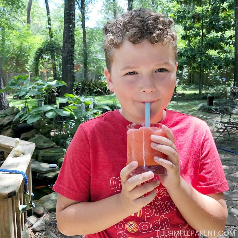 Boy drinking frozen strawberry lemonade