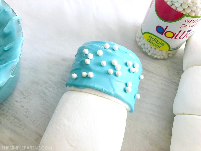 Putting sprinkles on flag marshmallow pops