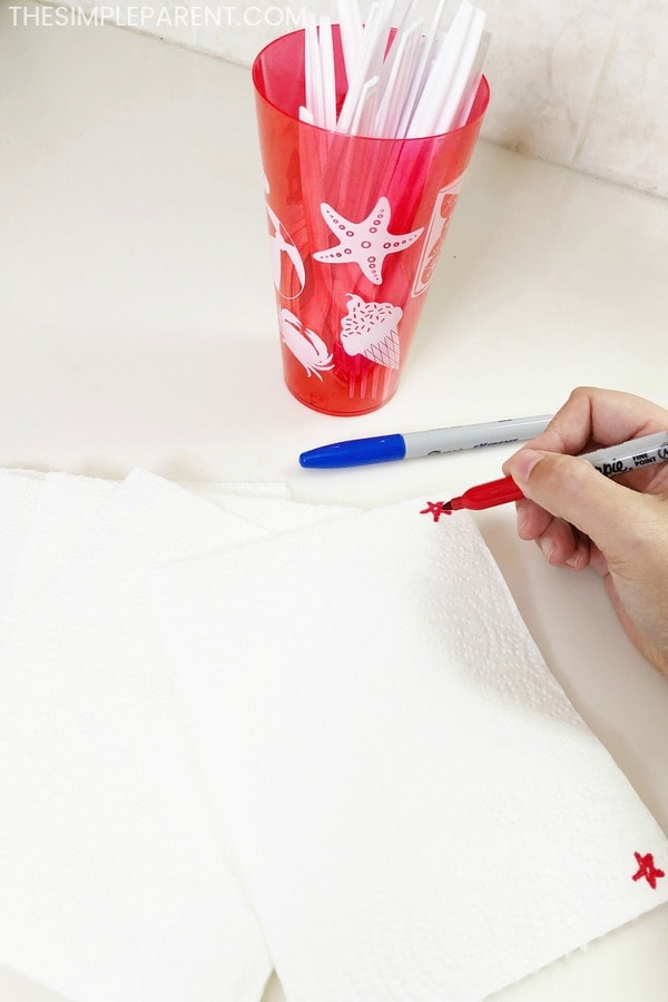 Drawing stars on napkins for July Fourth entertaining