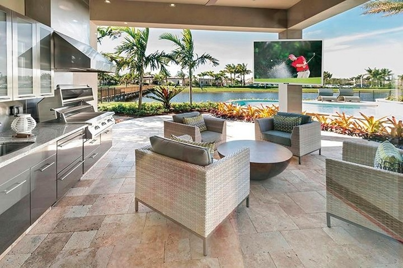 An outdoor television on a covered deck.