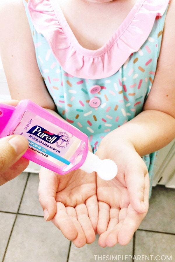 Girl using PURELL hand sanitizer
