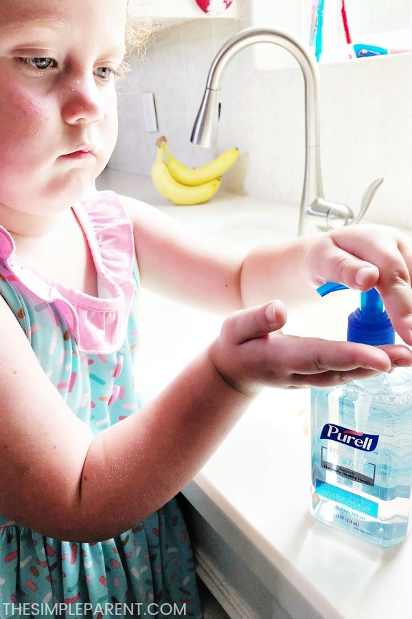 Girl using PURELL hand soap in the kitchen
