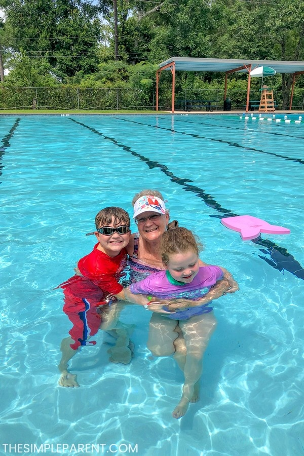 Grandmother swimming with grandkids