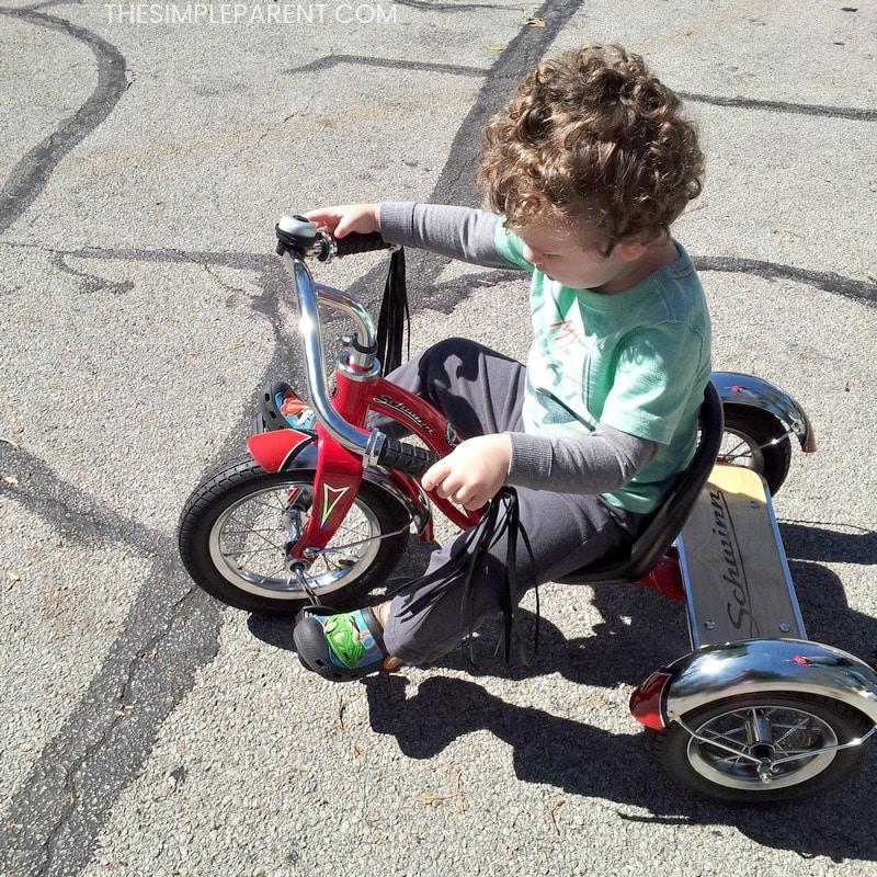 Preschool boy riding a tricycle