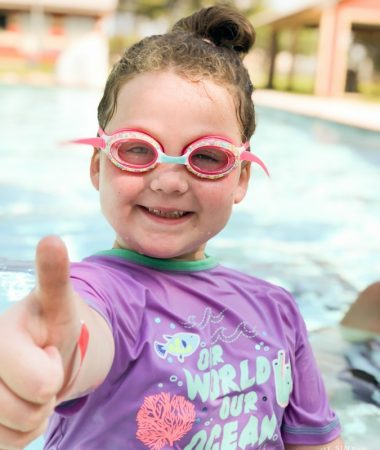 Little girl giving a thumbs up